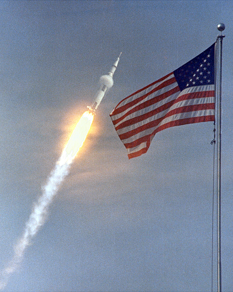 1. The flight of Apollo 11, the first Lunar landing mission. The Apollo 11 Saturn V space vehicle, or rocket, lifted off with astronauts Neil A. Armstrong, Michael Collins and Edwin E. Aldrin, Jr., at 9:32 a.m. EDT July 16, 1969, from Kennedy Space Center's Launch Complex 39A. Flying at transonic speeds -- speeds varying near and at the speed of sound (supersonic) -- can generate impressive condensation clouds caused by the Prandtl-Glauert Singularity. For a scientific explanation, see Professor M. S. Cramer's Gallery of Fluid Mechanics, Prandtl-Glauert Singularity at <http://www.GalleryOfFluidMechanics.com/conden/pg_sing.htm>; and Foundations of Fluid Mechanics, Navier-Stokes Equations Potential Flows: Prandtl-Glauert Similarity Laws at <http://www.Navier-Stokes.net/nspfsim.htm>. Photo Credit: Apollo 11 Launch, July 16, 1969, GRIN (http://grin.hq.nasa.gov) Database Number: GPN-2000-000627, National Aeronautics and Space Administration (NASA, http://www.nasa.gov), Government of the United States of America.