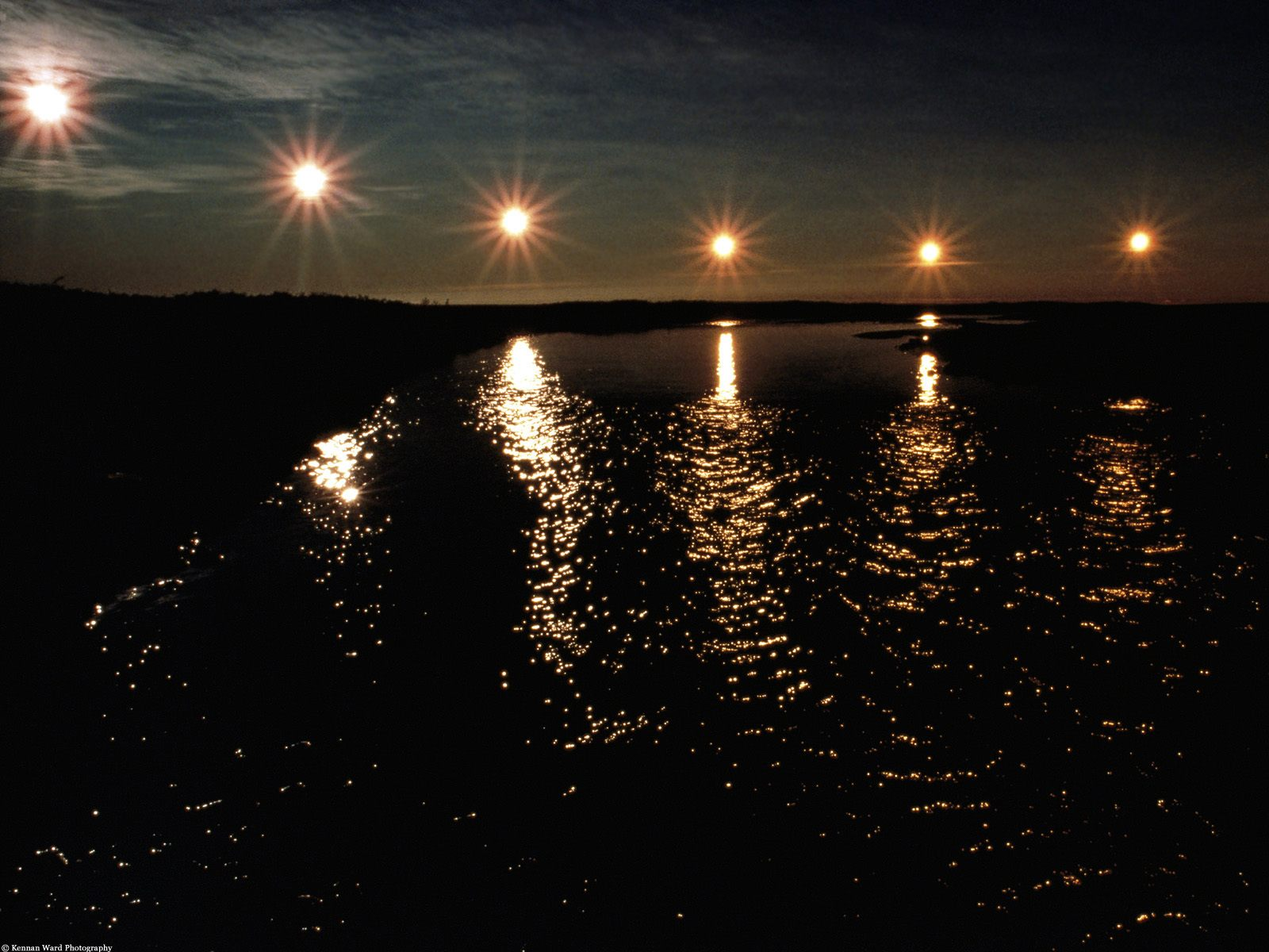 midnight sun and aurora with moon